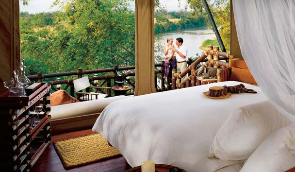 Four Seasons Tented Camp Golden Triangle: Couple Enjoying Deluxe Tented Camp