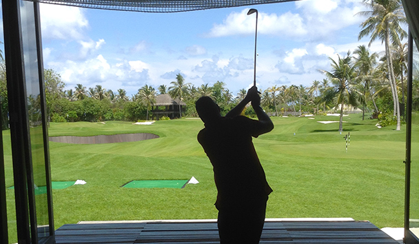 Julie's image of Paul using the Golf simulator at Velaa Private Island