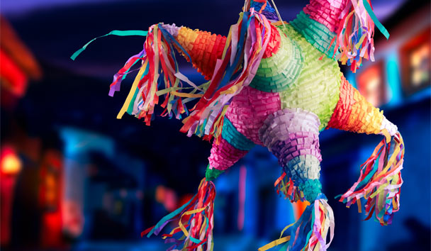 Mexican children celebrate with a treat-filled piñata
