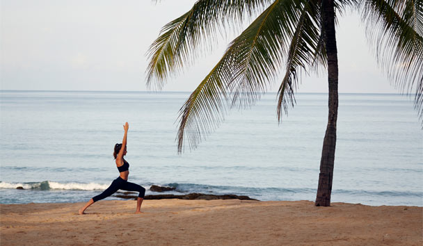 Yoga on the beach at Iniala Beach House