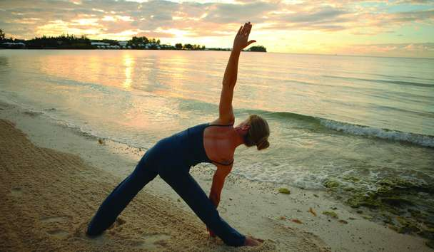 Cambridge Beaches Resort & Spa: Yoga on the beach