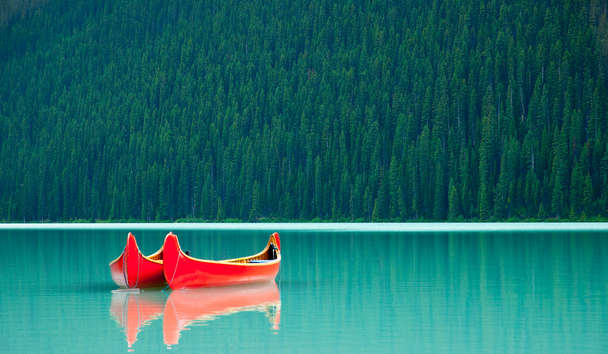 Canoes Floating on Lake Louise, Banff National Park, Canada